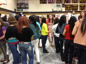 Junior high girls visit with women representing over 50 careers.